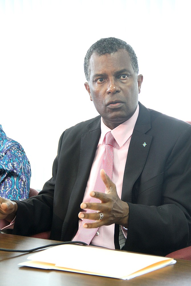 Minister of Foreign Affairs and Immigration Fred Mitchell at a press conference at the Department of Immigration on Sunday.