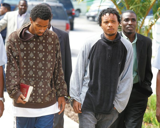 Sebastian Cartwright, left, holding a Bible, and Ravon Dwight Major outside of court.