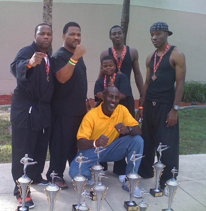 Sensie Winston Penn (front row) is flanked by Corey 'DJ' Counsellor' Rolle, Sensie Jason Basden and a few young martial artists.