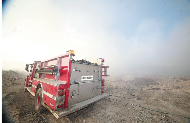 Firefighters in the thick of the smoke where they continued to damp down the fire.