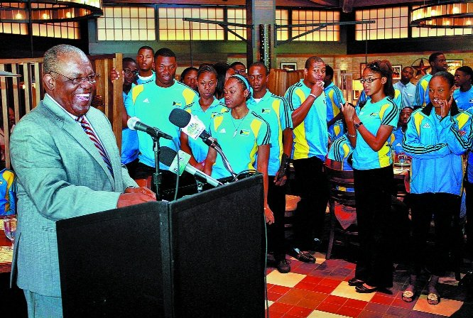 PRIME MINISTER Hubert Ingraham welcomes the Carifta competitors upon their return to the Bahamas.