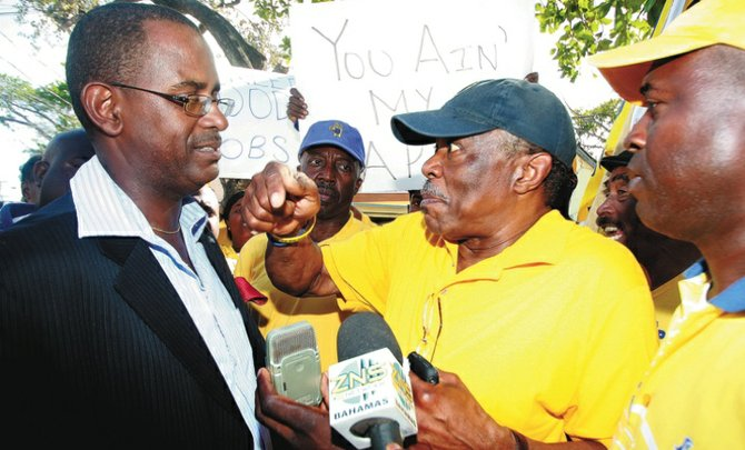 Minister of National Security Tommy Turnquest is confronted by Bain and Grants Town candidate Dr Bernard Nottage.