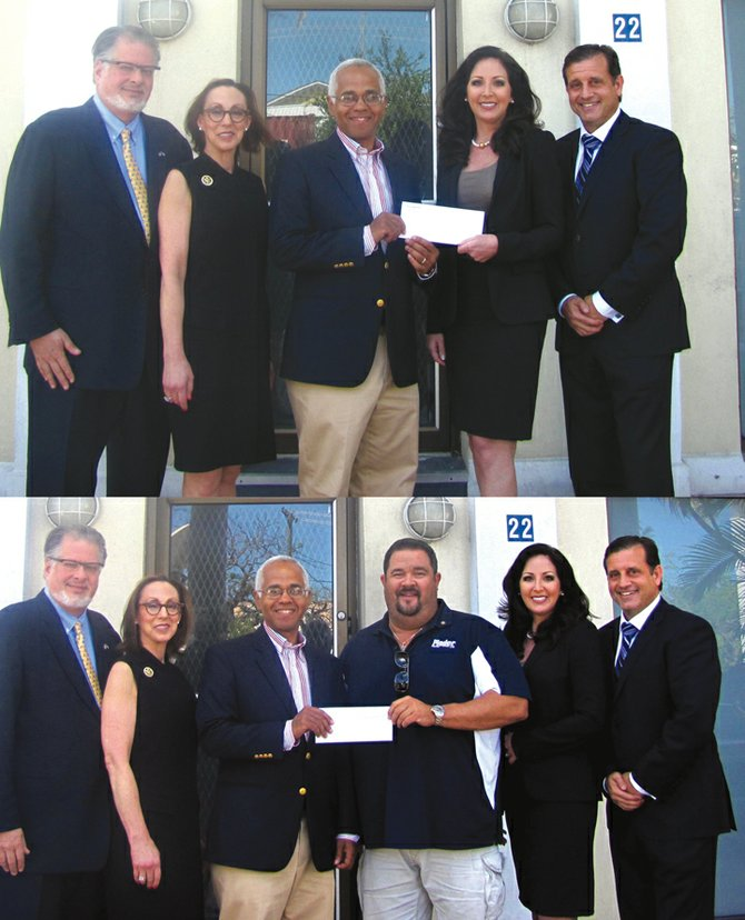 Two cheques are handed over to the Bahamas Breast Cancer Initiative. In the top picture are: Former US Ambassador to the Bahamas Ned Siegel and his wife Stephanie, Dionisio D'Aguilar, Michelle Rassin and Robert Carron at the handover. In the bottom picture a second cheque for $5,000 is presented by Adam Darville, president of the Rotary Club of East Nassau.