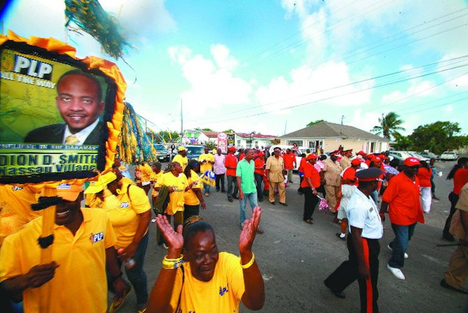 PLP supporters heckle the Prime Minister during his walkabout.