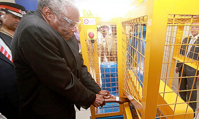 National Security Minister Dr Bernard Nottage destroys a gun using the new equipment.