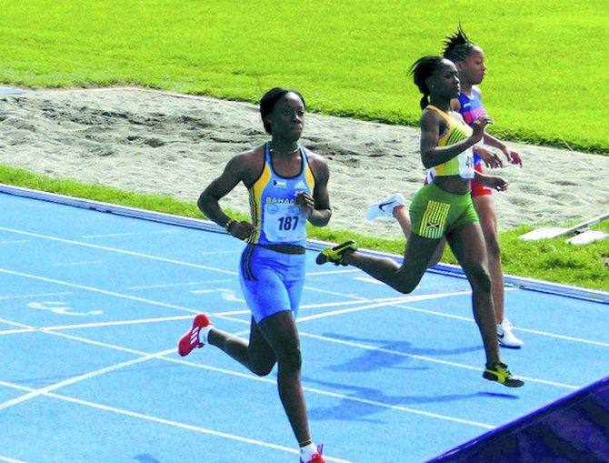 CARMEISHA COX (far left) won silver in the 200 meters on Saturday night.