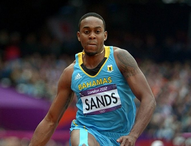 Leevan Sands bounds an automatic qualifying mark of 56-4 (17.17m) in the mens triple jump quallifying during the London 2012 Olympic Games at Olympic Stadium.  Kirby Lee-USA TODAY Sports