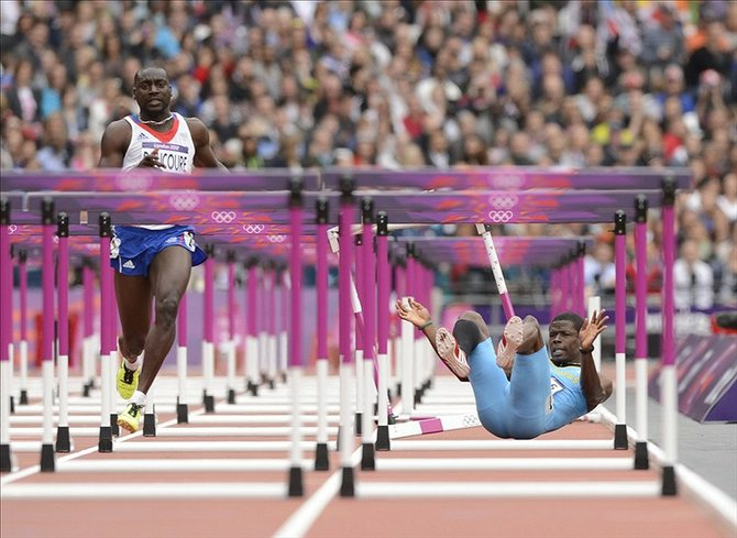 Shamar Sands (BAH) falls during the mens 110m hurdles heats during the London 2012 Olympic Games at Olympic Stadium. Robert Deutsch-USA TODAY Sports