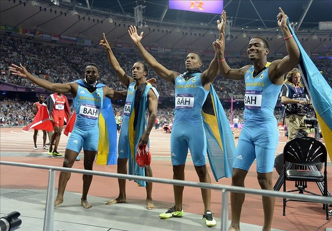 The triumphant Bahamas relay team celebrate after winning the gold in the Men's 4x400m Final. Kirby Lee-USA TODAY Sports