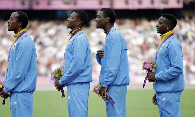 The Bahamas' men's 4x400-metre relay team of Chris Brown, Demetrius Pinder, Michael Mathieu and Ramon Miller pose with their gold medals during the 2012 Olympic Games in London. (AP)