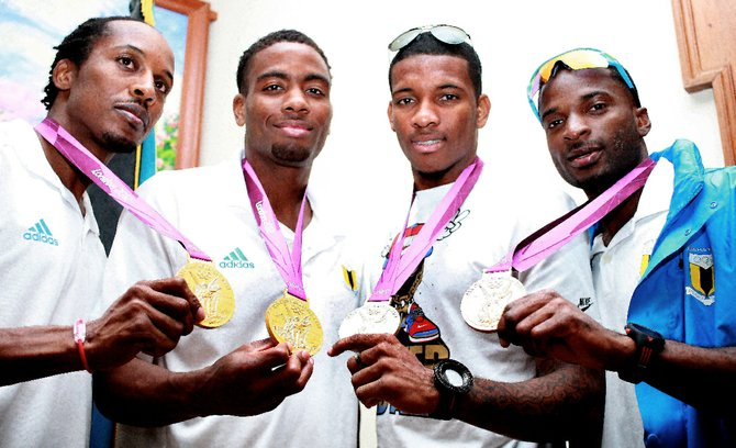 THE gold medal winning quartet of, from left, Chris Brown, Michael Mathieu, Demetrius Pinder and Ramon Miller show off their gold medals. Photos: Felipé Major/Tribune Staff