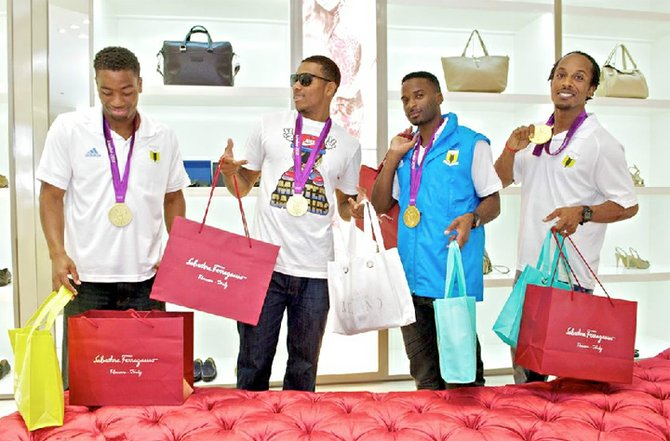 "Gold medal Olympic heroes Michael Mathieu, Demetrius Pinder, Ramon Miller and Chris Brown enjoy gifts presented by Carlo Milano in Nassau. Gift bags for the 'Golden Boys' included Carlo Milano watches, Versace sunglasses and cologne and Ferragamo shoes.  Sylvia Chee-A-Tow, of Carlo Milano, said: ""We are so proud of Team Bahamas for bringing home the gold, we wanted to shower them with gifts!"" Picture courtesy of BVS."