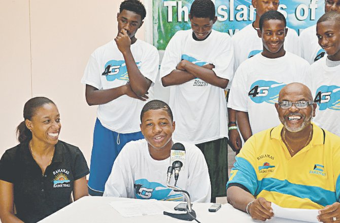 Shamar BURROWS, a member of the CentroBasket Under-15 team, speaks on behalf of his teammates at Wednesday's press conference. The team is scheduled to leave today for the August 25-29 tourney in El Salvador. BBF president Charles Robins (far right) looks on.                    Photo: Davario Rahming