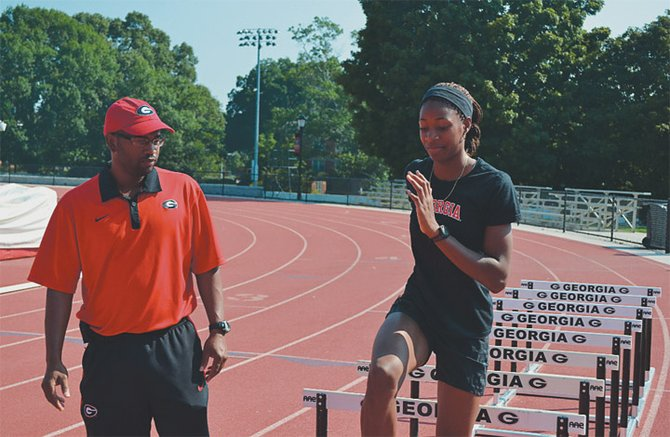 Coach George Cleare and Shaunae Miller go through a training session at the University of Georgia.