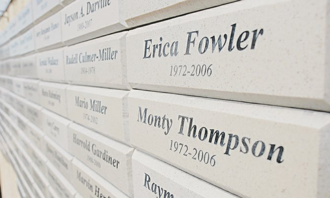 The Memorial Wall at New Covenant Baptist Church, commemorating murder victims, including the name of murder victim Erica Fowler, an employee of The Tribune at the time of her death.
