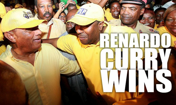 Prime Minister Perry Christie congratulates Renardo Curry on Monday night. Photo: Felipé Major/Tribune staff