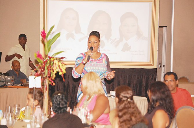 Host Phyllis Garraway entertains audience.