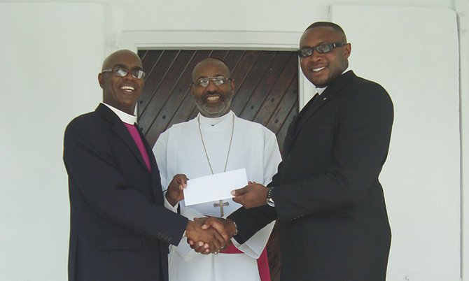 James Palacious, Bishop Laish Boyd, The Reverend Tellison Glover at a cheque presentation for St. Philips Anglican Church.