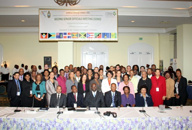 Environment and Housing Minister Kendred Dorsett, seated centre, along with Minister for Grand Bahama, Dr Michael Darville, and delegates at the Caribbean Challenge Initiative two-day conference.