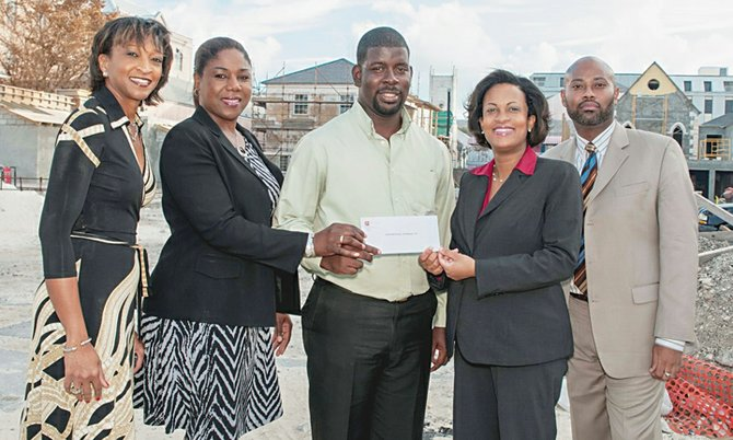 CIBC FirstCaribbean's managing director, Marie Rodland-Allen (second from right), presents the Downtown Nassau Partnership's project manager, Gevon Moss (centre), with a donation valued at $25,000 to help with financing the redevelopment of Nassau's city centre, including the historic Pompey Museum site. Also shown are DNP's director, Inga Bowleg (left); CIBC FirstCaribbean's marketing manager, Andrea Myers-Tanguay (second from left); and DNP's director, Jermaine Wright, is pictured at right.