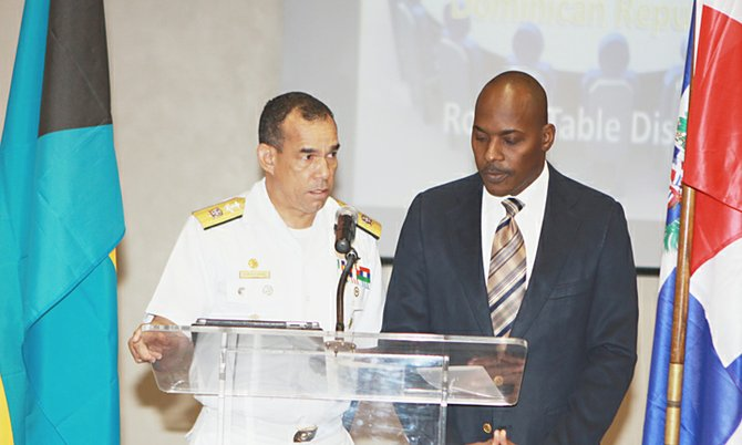 Rear Admiral Felix Alburerque-Compress of the Dominican Republic Navy (left) addresses the opening sessionof the Royal Bahamas Defence Force/Dominican Republic Navy round table discussion on Tuesday at Police Headquarters. Sub-Lieutenant Glen McPhee of the National Intelligence Agency (Bahamas) served as interpreter.