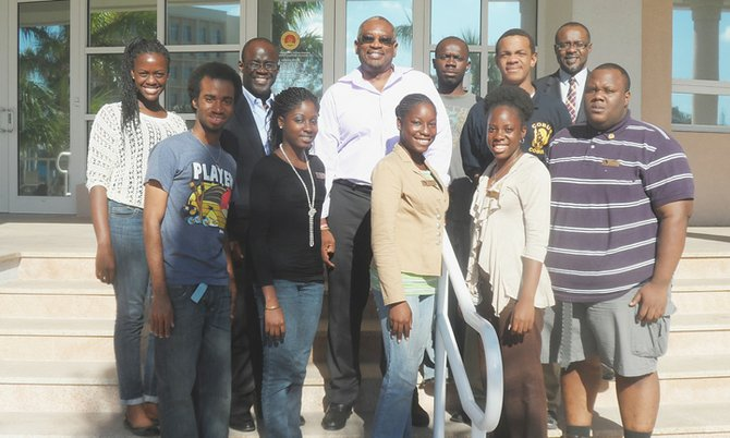 Dr HUBERT Minnis and members of COBUS in front of the Harry Moore Library. From left, front row: Amard Rolle, Marquel Wallace, Lakeisha Rolle, Jan Turnquest, and Alphonso Major. Back row: Lona Bethel, Darron Cash, Dr Minnis, Franklyn Donaldson, Ernesto G Williams, John Bostwick.