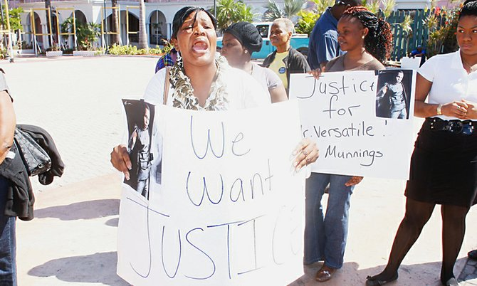 PROTESTERS took to the streets yesterday in Nassau over recent deaths in police custody, such as this woman who took part in the protest outside Parliament, and were joined by people asking for more answers over the recent shooting of Job Munnings. 