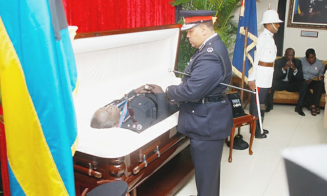Commissioner of Police Ellison Greenslade pays his respects. Photo: Tim Clarke/Tribune Staff.