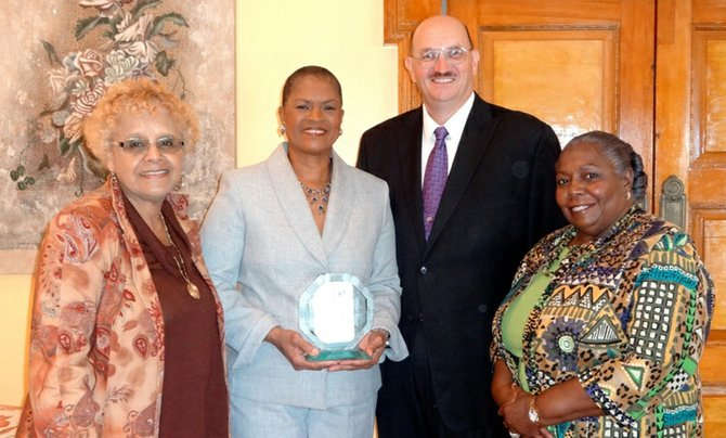 (From left to right) Dr Sandra Dean Patterson, International Women of Courage award recipient Missouri Sherman-Peter, US Chargé d'Affaires John Dinkelman and Janet Bostwick.