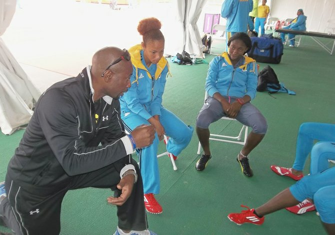 Henry Rolle speaks with Aymara Jones and Anthonique Strachan (right) at the London Olympics.