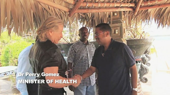 Dr Perry Gomez with Peter Nygard in the video.