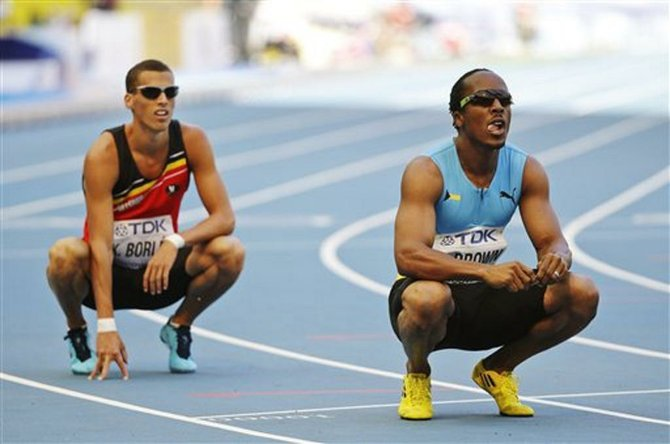 Chris Brown, right, and Belgium's Kevin Borlee look at the timing board after a men's 400-meter heat at the World Athletics Championships in the Luzhniki stadium in Moscow, Russia, Sunday, Aug. 11, 2013. (AP Photo/Anja Niedringhaus)