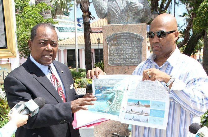 Rev CB Moss points out what is said to be an expanded area of land at Simms Point yesterday in a press conference held in Rawson Square. Also pictured is activist/filmmaker Celi Moss.
