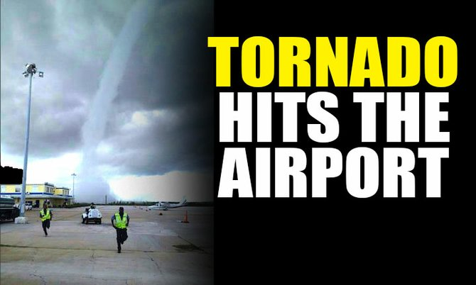 A reader sent us this photo of a tornado at the airport this afternoon.