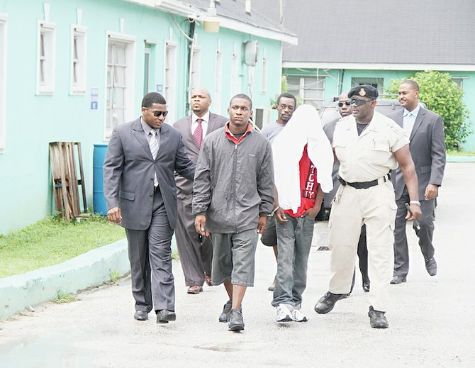 22-year-old Veron Hart (black jacket) and a 17-year-old were charged with the September 3 murder of Ned Joseph. At the back in the black shirt is 41-year-old Charles Williams, of Labour Street, who was charged in connection with the August 24th murder of Diontroy Moxey.