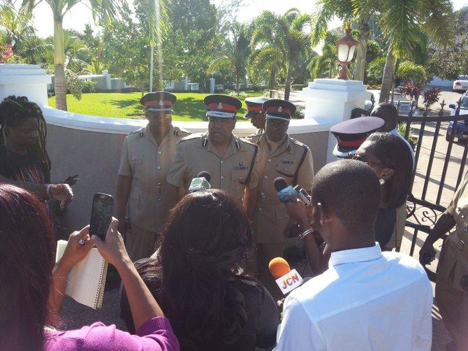Commissioner of Police Ellison Greenslade talks to reporters outside of Deputy Prime Minister Philip 'Brave' Davis' home.