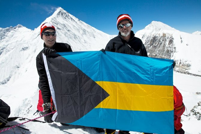 "COLUMBUS might have discovered the Bahamas, but wherever Harry McPike goes so goes the Bahamas flag to be planted on mountain peaks, both at the top and bottom of the world – in Africa, South America and now in the Himalayas. The flag is donated by Mr Peter Bates, ""The Sign Man"" on Shirley Street, and to date flies from a 23,100 ft peak in the Himalayas, 19,341 ft Mt Kilimanjaro in Tanzania, the 20,720 ft Mt Chimborazo in Ecuador. Last year it even made it to the South Pole. Shown here on April 26 this year are Mr Peter Wirth (left) senior relationship manager of Credit Suisse, and Mr McPike on the 23,100 ft Lhakpa-Ri peak with Mt Everest in the background."