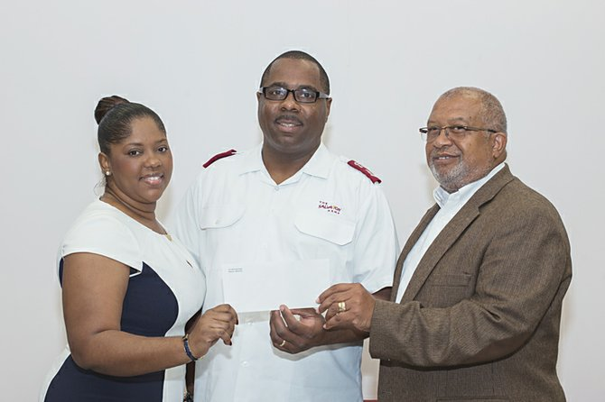 Commonwealth Bank's Tameka Cooke, left; and Charles Knowles, far right, present cheque for $5,600 to Major Lester Ferguson, divisional commander of the Salvation Army.