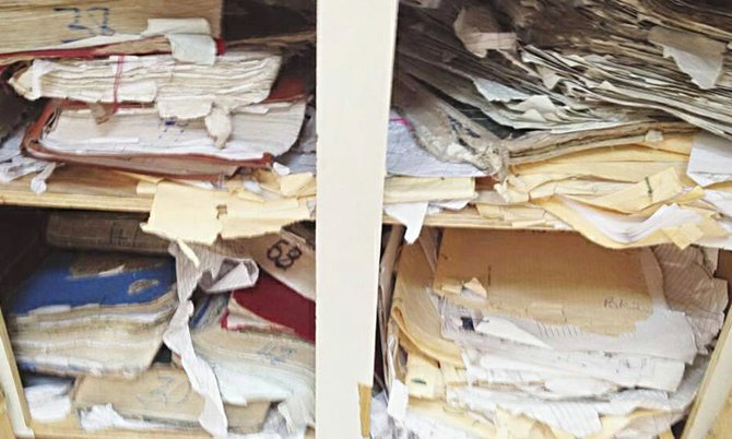 Some of the stacks of files said to be part of the Supreme Court backlog - stacked in tattered folders and in poor condition.