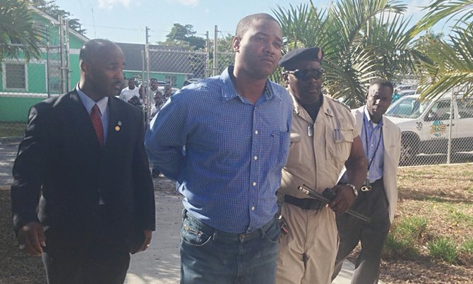 Constable Narado Rolle is escorted to court.