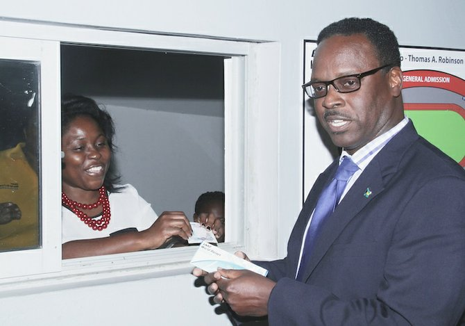 Minister of Youth, Sports and Culture Dr Daniel Johnson yesterday buys the first two $50 gold seat tickets for the IAAF World Relays Bahamas 2014.