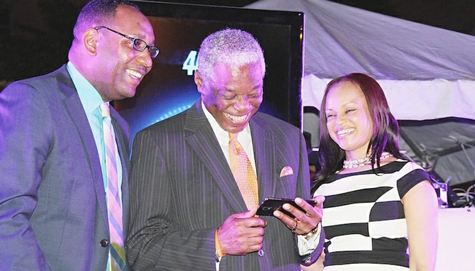 Senior public relations manager Jerome Sawyer, Minister of National Security Bernard Nottage and Manager of Mobile Product Development Alphanique Duncombe at last night's launch.