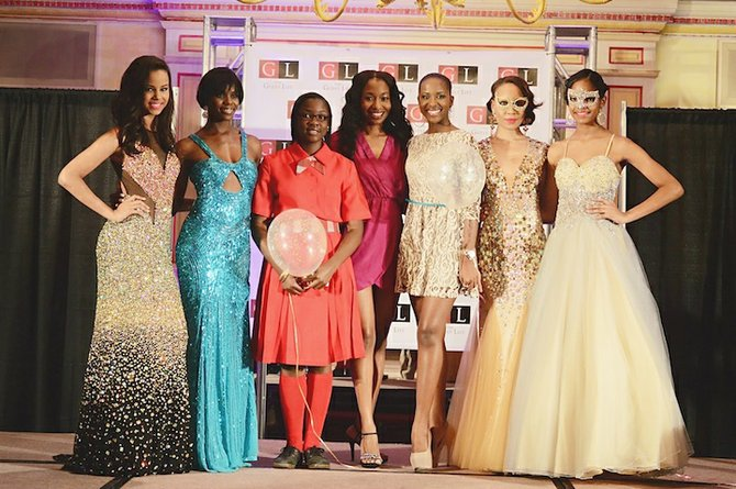 Prom package winner Rhodesia Johnson (third from right) with Aquelle Tuletta (fourth from right), runner-up Delshama McKenzie (third from left) and the Cinderella models. (Photo/Jay Isaacs Photography)
