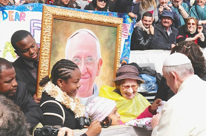 Jamaal Rolle carries his portrait as he comes face-to-face with the Pope himself.