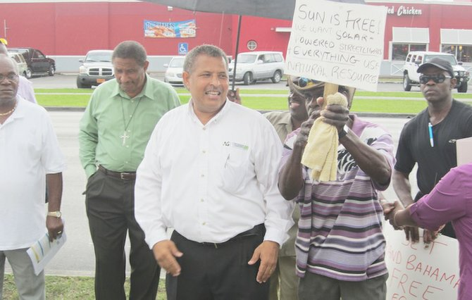 MEMBERS of the protest group at the last demonstration held against the cost of power in Grand Bahama.