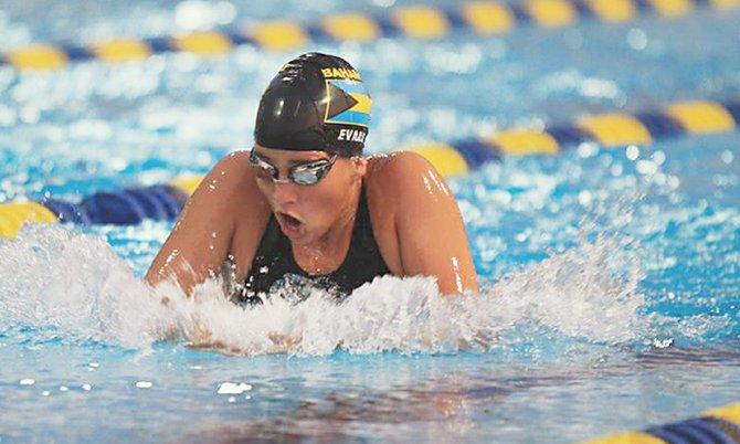 JOANNA EVANS won gold in the girls' 15-17 200m IM.