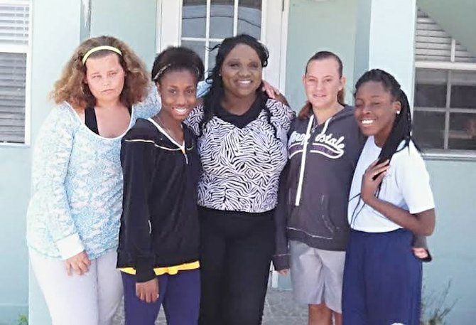 Tiffany Rahming (centre) with her scholars at the Trinity Preparatory Academy in Abaco.