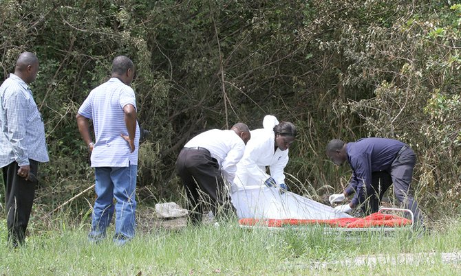 Police remove the body from the scene.