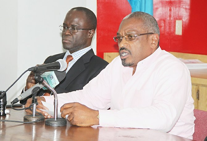 FNM leader Hubert Minnis (right) with party chairman Darron Cash at Thursday night's press conference.