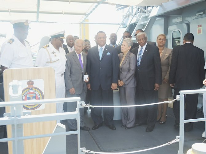 Prime Minister Christie and Arthur D Hanna pose with cabinet ministers aboard the HMBS Arthur Dion Hanna during an inspection ceremony yesterday.